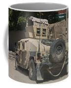 A Humvee Patrols The Streets Of Kunduz Coffee Mug