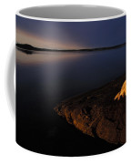 A Husky Reclines On The Shore Coffee Mug by Nick Norman