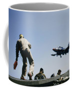 A Jet Lands Onboard An Aircraft Carrier Coffee Mug by J Baylor Roberts