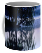 A Large Tree Grows At The Edge Coffee Mug