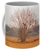 A Leafless Tree That Is Home To A Large Number Of Big Birds In The Middle Of A Ground Coffee Mug