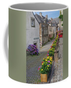 A Line Of Flowers In A French Village Coffee Mug