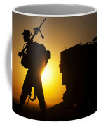 A Machine Gunner Prepares To Load An Coffee Mug