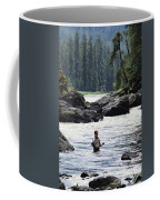 A Man Fishes For Cutthroat Trout In An Coffee Mug