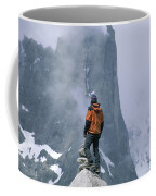 A Man Stands On A Cliff Watching Coffee Mug