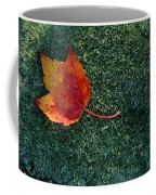 A Maple Leaf Lies On Emerald Moss Coffee Mug