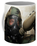 A Marine Drinks Water From A Canteen Coffee Mug