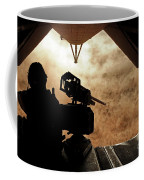 A Marine Waits For Dust To Clear While Coffee Mug