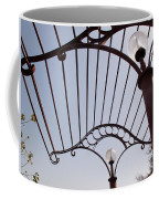 A Metal Structure That Is Part Of The Lamp Shade Arrangement In A Garden Coffee Mug