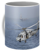 A Mh-60s Knighthawk Conducts A Vertical Coffee Mug by Gert Kromhout
