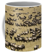 A Migrating Herd Of Wildebeests Coffee Mug