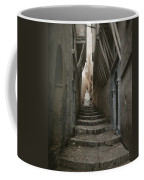 A Muslim Woman Walking Down A Steep Coffee Mug by Gervais Courtellemont