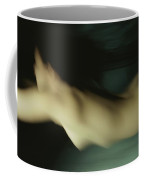 A Nude Swimmer In A Mermaid-like Coffee Mug