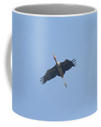 A Painted Stork Flying High In The Sky Coffee Mug