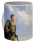 A Paratrooper Looks On As Other Coffee Mug