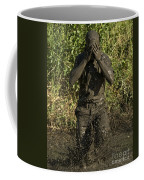 A Participant Wipes Mud From His Face Coffee Mug