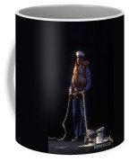 A Petty Officer Secures Rope Tied Coffee Mug