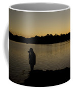 A Photographer At Work During Sunset Over A Lake Coffee Mug