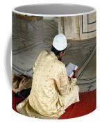 A Pious Devotee Reading The Quran Inside The Jama Masjid In Delhi Coffee Mug