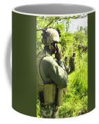 A Riverine Soldier Radios In Mock Coffee Mug