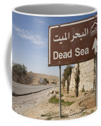A Road Sign In Both Arabic And English Coffee Mug by Taylor S. Kennedy