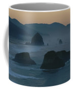 A Rocky Shoreline Is Silhouetted Coffee Mug
