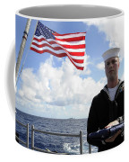 A Sailor Carries The National Ensign Coffee Mug