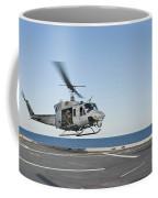 A Sailor Directs A Uh-1n Huey Coffee Mug