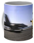 A Sailor Ensures An Fa-18c Hornet Coffee Mug by Stocktrek Images