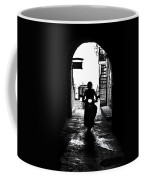 a scooter rider in the back light in a narrow street in Italy Coffee Mug by Joana Kruse