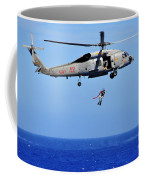 A Search And Rescue Swimmer Is Lowered Coffee Mug