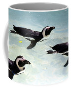 A Small Squadron Of Swimming Penguins Coffee Mug