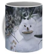 A Smiling Snowman With Twig Arms Coffee Mug