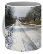 A Snow-covered Road Passes Coffee Mug by Joel Sartore