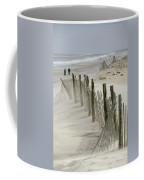 A Snow Fence Stretches Across A Dune Coffee Mug by Skip Brown