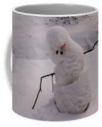 A Snowman Sitting In The Snow Coffee Mug
