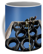 A Soldier Climbs Over A Tire Tower Coffee Mug