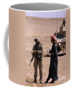 A Soldier Communicates With A Local Coffee Mug
