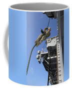 A Soldier Fast-ropes From The Rear Coffee Mug by Stocktrek Images