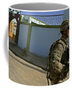 A Soldier Patrols The Streets Of Qalat Coffee Mug