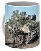 A Soldier Stands Beside A Camouflaged Coffee Mug