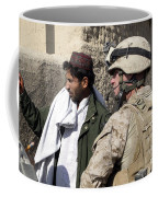 A Soldier Talks To A Local Villager Coffee Mug