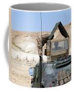 A Soldiier Instructs An Iraqi Army Coffee Mug