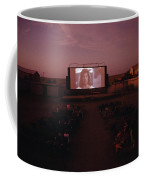 A Sparse Audience Watches A Film Coffee Mug by Sam Abell