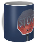 A Stop Sign Covered In Snow Coffee Mug by John Burcham