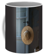 A Sun Hat Hangs On The Door Of A Tuscan Coffee Mug