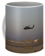 A Uh-60 Blackhawk Helicopter Flies Coffee Mug by Terry Moore