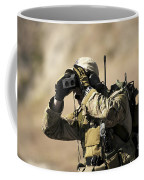 A U.s. Air Force Combat Controller Uses Coffee Mug by Stocktrek Images