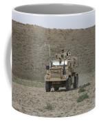 A U.s. Army Cougar Patrols A Wadi Coffee Mug