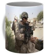 A U.s. Marine Gives A Piece Of Candy Coffee Mug